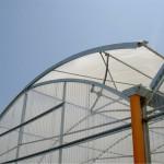 serra con copertura in policarbonato con apertura a mezzo arco